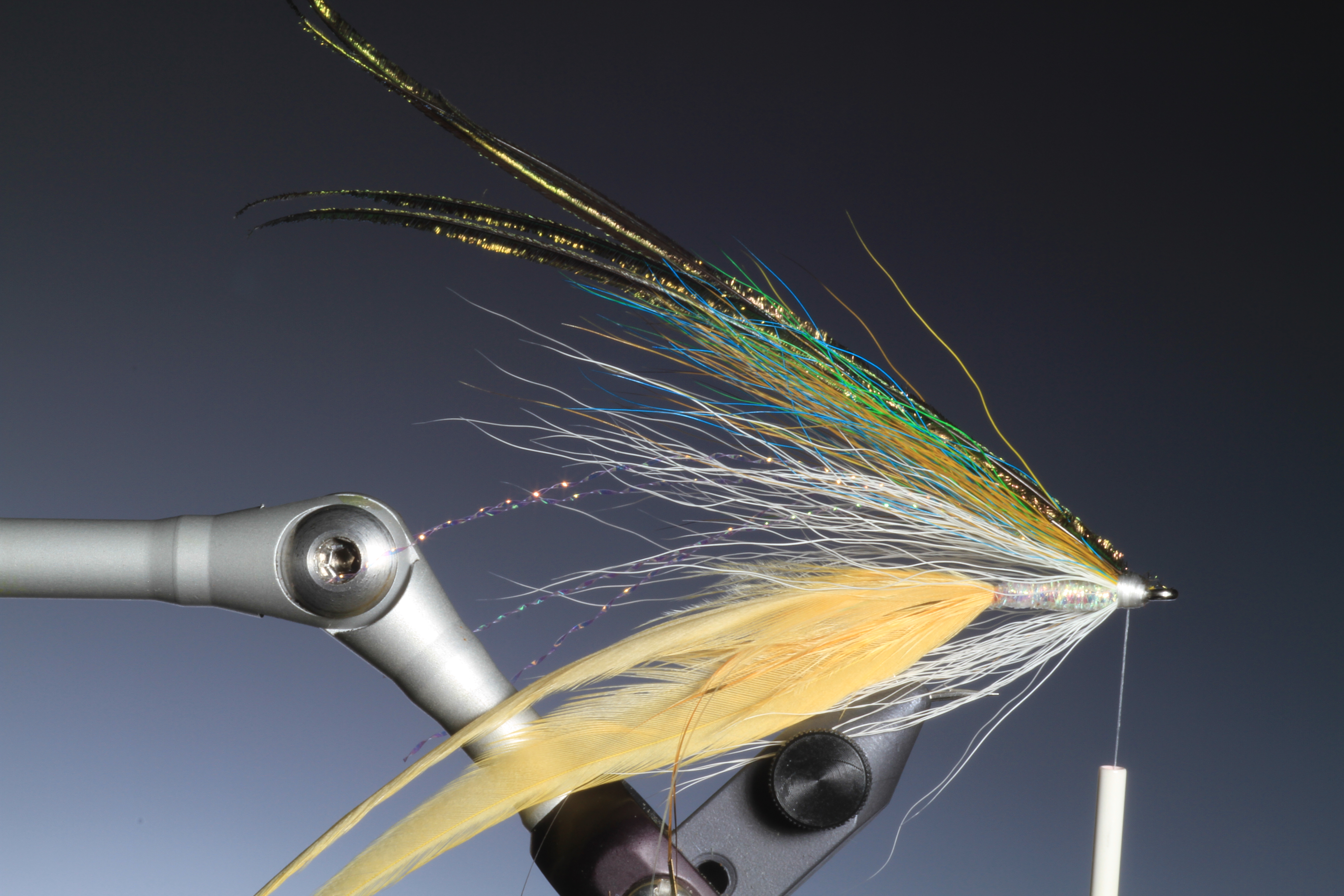 9. Top off the wing with four or five strands of peacock herl.